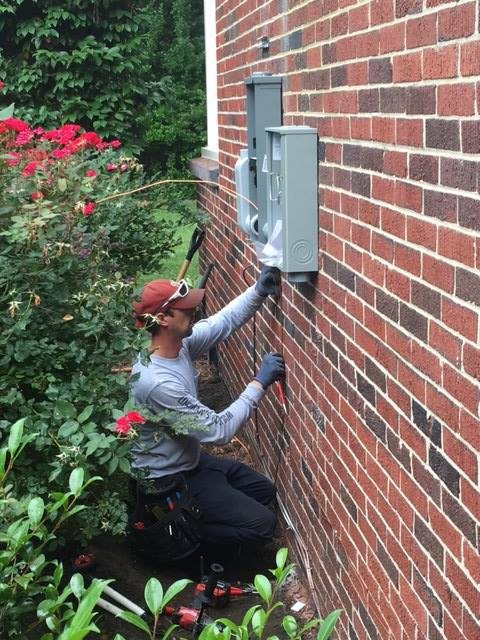 Technician Working on Outdoor Panel
